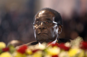 Zimbabwean President Robert Mugabe attends a meeting with the country's war veterans in Harare, Thursday, April, 7, 2016. The meeting was held following complaints by the veterans that Mugabe had abandoned them for a younger faction of the party led by his wife Grace. In his speech Mugabe called on unity and discipline among the veterans. (AP Photo/Tsvangirayi Mukwazhi)